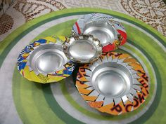 beer/soda can ash trays.  The page is not in English but that doesn't matter.... watch the video... Great Idea!!