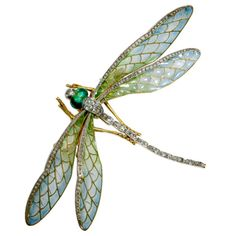 Art Nouveau Dragonfly Brooch ~ France late 19th century/early 20th century (attributed to Eugene Feuillatre) mounted en tremblant, its wings plique-a-jour enamel and edged in rose-cut diamonds. Its head with green enamel eyes and a diamond. From the original Fred Leighton! Price $37,500 ~ I love insect brooches!