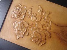 rosas cuero badana,base de plastilina y cola,patina y cera natural repujado. cordoban,patina y cera