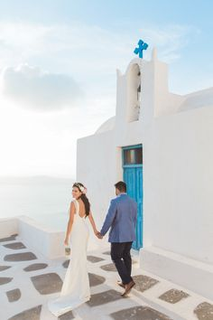 Photography: Anna Roussos - Photographer - annaroussos.com Read More on SMP: http://www.stylemepretty.com/destination-weddings/2016/03/18/elopement-in-santorini-island/