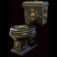 The dark colour with the intricate embellishment might suggest this toilet is from the Gothic era, but its actually third empire kitsch chic.