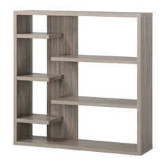This modern bookshelf features offset media shelving with broad display shelving. It can be reversed for different looks and makes a great media center.