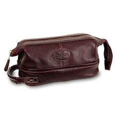 """Keep all your essentials in one place with this toiletry case made of soft chocolate brown American cowhide leather. Fully lined with a zippered interior enclosure it's built to last with metal framing along the top zipper closure. 10""""W x 6""""D x 5""""H. Made in USA."""