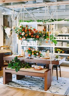 Orange boho tablescape with a suspended arrangement