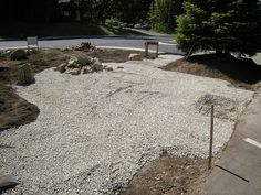 the patio space is prepared with a layer of 34 crushed stone in order - Crushed Stone Patio