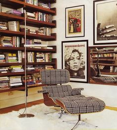 Beautiful library. I want to find a cheapo Eames knock-off and have it reupholstered thusly.