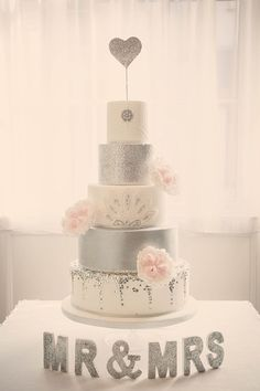 5 tier vintage wedding cake with silver and pink decor