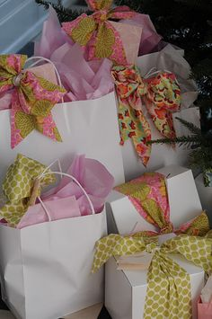 Start with white bags and boxes; then add colorful tissue and fabric bows for a lovely dressed up look.