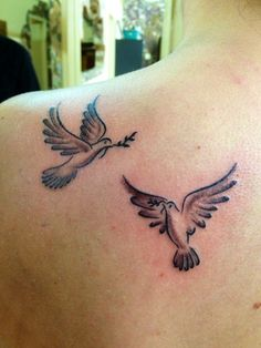 Dove and olive branch tattoo.