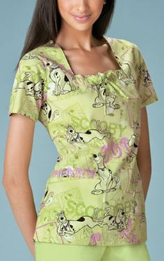 "Square Neck Top in Scooby Cool A square neck top features neck inset with drawstring, bust darts, two patch pockets, side vents, and half back elastic for a slimming shape. Center back length: 26""  Fabric: Brushed Poly/Cotton Poplin $27.99"