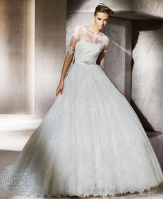 Romantic lace ballgown wedding dress with sheer sleeved bolero and bridal belt