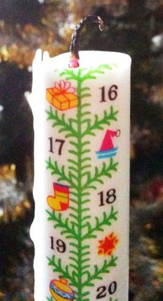 "Advent Calendar Candle - Christmas Tree. Advent Calendar Candle - Christmas Tree with Star . 15"" tall. Celebrate the Advent Season by burning this candle day-by-day. Marked 1-24. Originally a Danish tradition. A memorable way to await Christmas."