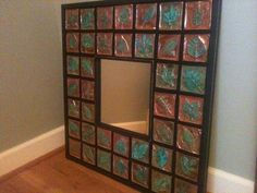 7th grade 2013 - embossed copper tiles with patina finish - copper tacks into black painted wood frame - native trees of Indiana