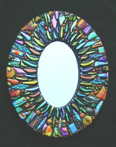 "Dichroic glass mosaic mirror - ""Bling"".   Super cool."