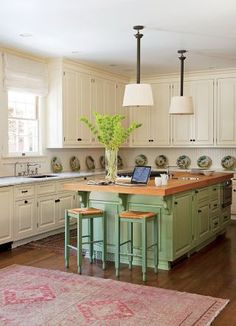 In Timothy Corrigan's Los Angeles home, the kitchen cabinetry is painted in shades of white and green by Farrow & Ball