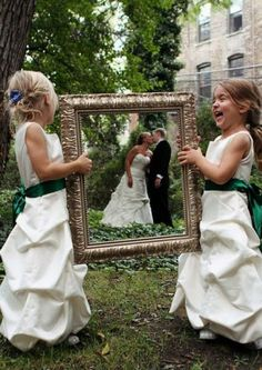 Isn't that cute! to have the little girls in dresses just like the brides, too bad I don't have any nieces! Maybe I'll have some by the time I get married?