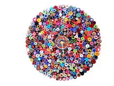 This is made out of recycled magazines! It's fun, cute and eco friendly. Love it!  Colorful Wall Clock  Magazine Beaded Clock Eco by Shannybeebo, $80.00