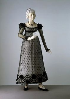 Evening dress, England, Britain ca. 1818. Machine made silk net, embroidered with silk, trimmed with satin decoration, wired epaulettes, hand-sewn.