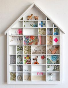 this is so cute! i have a wooden box like this (not house shaped, unfortunately) that i am planning to line with fabric, like this.