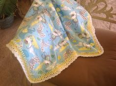 Baby blanket with monkeys and elephants with a crocheted edging by Lorettescottage on Etsy