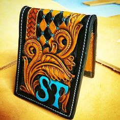 Finished up another wallet! #wallet #leathertooling #turquoise