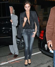 Victoria Beckham reveals a hint of cleavage in a sexy plunging sequin top in NY | Daily Mail Online