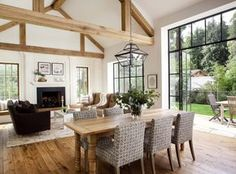 Chic modern farmhouse style. Rustic and modern with metal windows, natural wood finishes, wood beams, and nuetral decor.