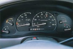 """The 1998 Ford Ranger EV's instrument panel included a """"Distance to Empty"""" gauge indicating how far the truck could be driven based on the amount of charge left in the batteries. The """"E"""" on the gear indicator stood for """"Economy Drive."""" When selected, it increased the amount of electrical regeneration when braking."""