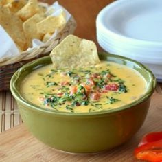 A grown up twist to your nacho cheese dip. Spinach, tomatoes, green chilies and bacon will make this dip a favorite for any occasion.