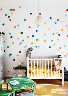 A colorful dot wall is perfect for a nursery.