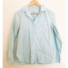 J. Crew Baby Blue Polka Dot Long Sleeve Top This button up by J. Crew is still in great condition. It's a light blue top with greenish looking polka dots. Hard to catch the colors in photos. J. Crew Tops Button Down Shirts