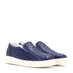 Bottega Veneta - Intrecciato leather slip-on sneakers - Bottega Veneta's sneakers are a luxe take on the traditional slip-ons. Crafted from signature woven leather and finished with a contrasting white sole, the bold blue design will work everything from denim to figure-hugging leather leggings. seen @ www.mytheresa.com