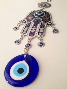 Evil Eye Wall Hanging blue glass evil eye wall hanging, metal finecut antique, magic