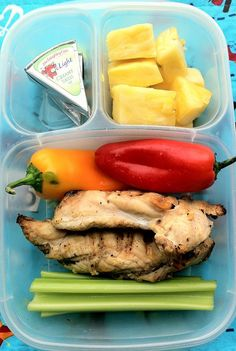 Husband's Lunch: grilled chicken left over from a playdate/BBQ. He has two pieces of chicken, surrounded by celery, sweet baby peppers, pineapple chunks, and two wedges of laughing cow lite. This is a nice lunch box meal that has some color and low-fat protein to help him stay full and hopefully avoid the snack truck at work!: http://bit.ly/ZZJdwA