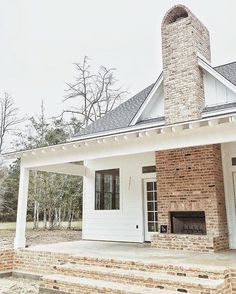 Outdoor fireplace – white farmhouse – black windows – exposed rafters on porch (…  http://www.4mytop.win/2017/08/06/outdoor-fireplace-white-farmhouse-black-windows-exposed-rafters-on-porch/