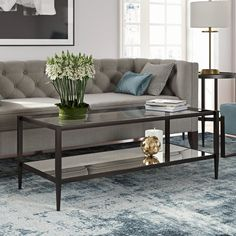 You can bring the glamour of Hollywood into your living room with the Hudson&Canal Wilda Coffee Table. This coffee table features a transparent tempered glass top, as well as a mirrored glass lower shelf that is both stylish and functional. Living Room Lighting Design, Tempered Glass Table Top, Living Room Storage, Modern Rustic Interiors, Living Furniture, Glass Shelves, All Modern, Home, Coffee