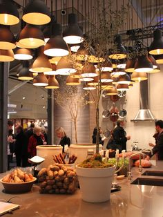 A cluster of pendant lights at the Ikea exhibit at #IDS13 | photo Chloe Berge