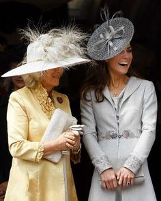 Catherine, Duchess of Cambridge chats with Camilla, Duchess of Cornwall (L) during the procession pass of the Order of The Garter Service in Windsor, England 13 June 2011