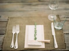Going to be reusing my wedding table setting for the holidays- name tags + holly sprig at each seat?