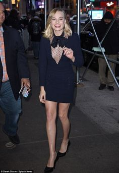 Racy! Braless Margot Robbie looked sensational as she slipped into a semi-sheer LBD during an appearance in New York on Thursday