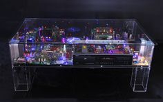 ~These Coffee Tables Contain Futuristic Neon Cityscapes Made From Recycled Electronics | The Creators Project