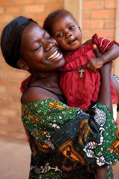 Chad: A woman living with HIV embraces her smiling daughter. She participated in a UNICEF-supported program to prevent mother-to-child transmission of the disease. As a result, her daughter is HIV-free! © UNICEF/NYHQ2011-2151/Esteve