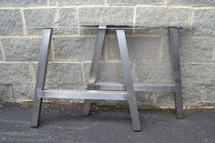 Build your own furniture with these custom legs! These unique table legs come with a brushed stainless steel finish. Made to ANY size up to 30x30. Price is PER SET of legs. Legs come standard with rubber inserts in the feet to protect the floor and with an industry leading top mounting plate size of 4 wide x 1/8 thick for optimum support and stability, with 1/4 holes spaced equally on both sides. Comes standard with a 12 degree taper, with the middle bar located 8-10 up. Bottom width is the…