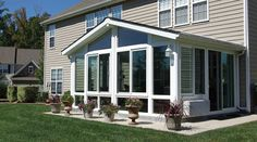 Looking for a four season vinyl sunroom? Take a look at this Patio Enclosures sunroom in white with shingled gable roof with glass wings and glass knee wall. Enclosed Front Porches, Enclosed Patio, Screened In Porch, Screen Porch Panels, Closed In Porch, Four Season Sunroom, Porch Enclosures, Screen Enclosures, Three Season Room