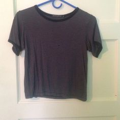 Grey and black striped Brandy Melville Crop Top Grey Brandy crop top with black stripes.                Super cute with shorts in the summer.☀️☀️☀️  Worn a couple times but in great condition  Brandy Melville Tops Crop Tops