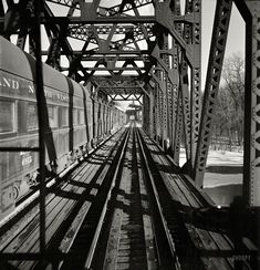 """January """"Freight operations on the Chicago & North Western R. between Chicago and Clinton, Iowa. The train crosses a long steel bridge."""" Medium-format negative by Jack Delano for the Office of War Information. Shorpy Historical Photos, Historical Pictures, Vintage Photographs, Vintage Photos, Famous Photographers, Train Tracks, High Resolution Photos, Large Painting, Black And White Pictures"""