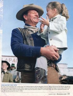 THE ALAMO (1960) - John Wayne with daughter Aissa on location near Brackettville, Texas - Directed by John Wayne - United Artists.
