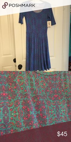 Brand new with tags--- LULAROE Nicole dress sz S Brand new with tags a lularoe dress in a Nicole in size small . Blue & pink very pretty just got off posh but too small . Asking what I paid . LuLaRoe Dresses Midi