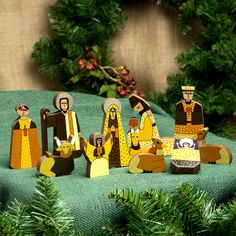 Handcrafted of pinewood, the nativity scene features the Three Kings bringing presents to the newborn Christ child. The nativity scene is painted by hand in rich earth colors by members of the God's Seed Cooperative in El Salvador.