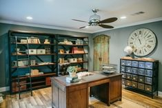 Gulley 36Desk, leather chair, and metal console from Laurie's Home Furnishings  Bookshelves from Arhaus